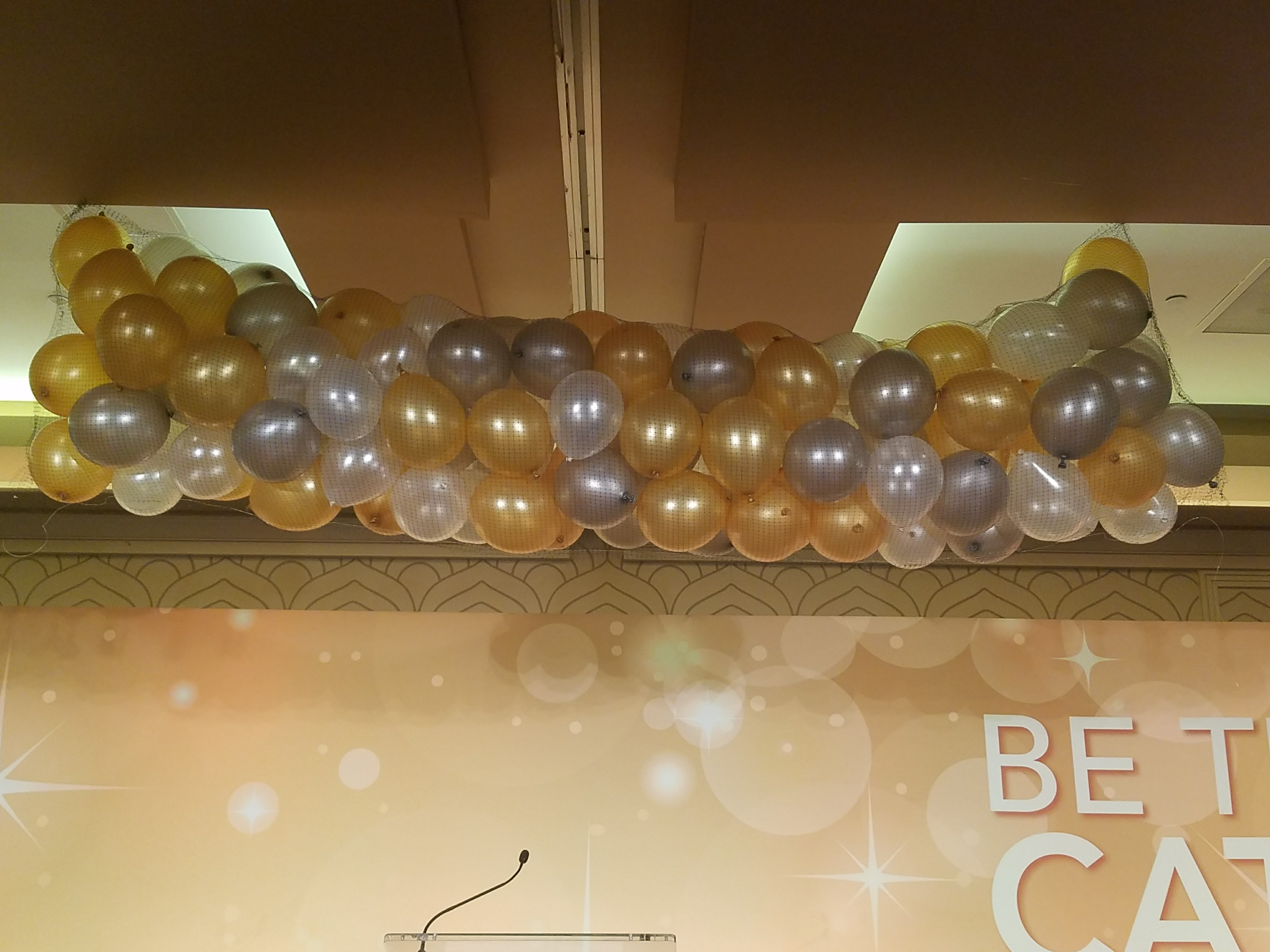 silver, gold, and white balloons